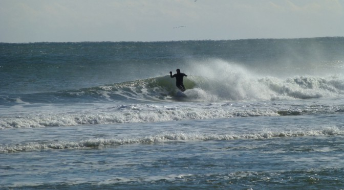Surfer At Nauset Beach In Orleans On Cape Cod On A Cold And Blustery January Day