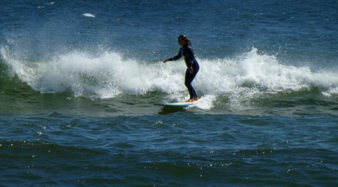 Surfer Girl Enjoying Coast Guard Beach in Eastham On Cape Cod