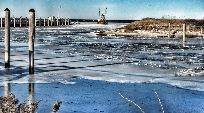 Old Fishing Boat In The Ice At Rock Harbor On Cape Cod