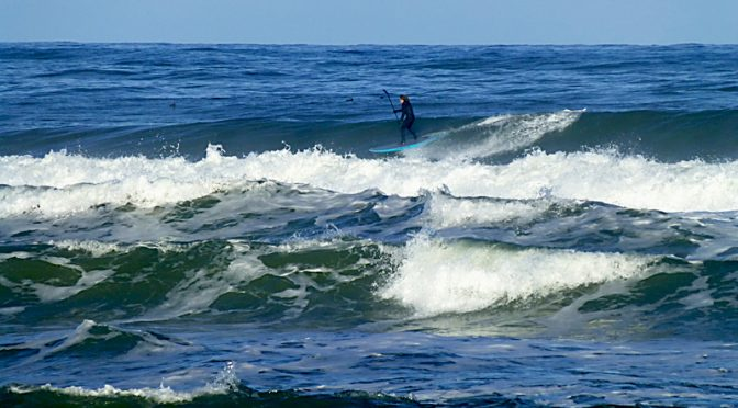 Paddle Surfing At Coast Guard Beach On Cape Cod In January