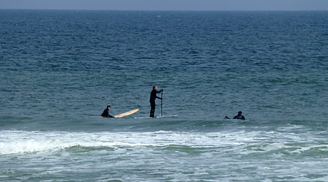 Surfers And A Paddle Surfer At Coast Guard Beach On Cape Cod