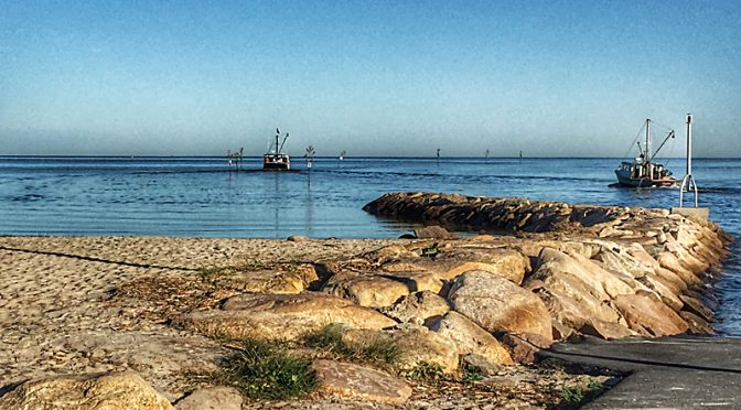 Fishing Boats At High Tide At Rock Harbor On Cape Cod