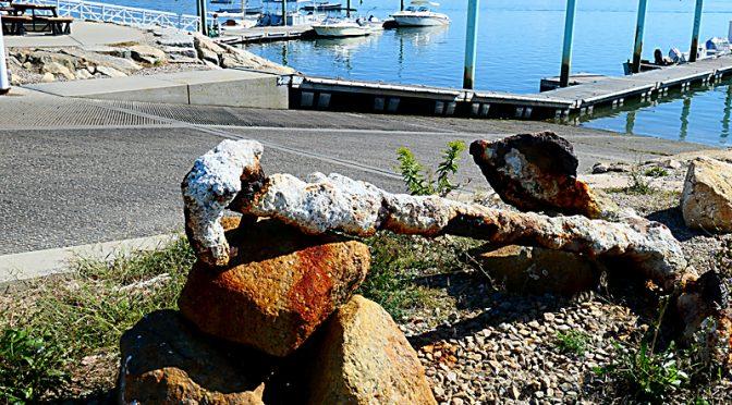Old Anchor At Wellfleet Harbor On Cape Cod.