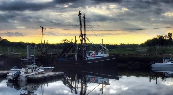 Beautiful Early Morning Stormy Reflection At Rock Harbor On Cape Cod.