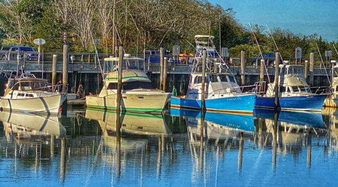 Colorful Boat Reflections At Rock Harbor On Cape Cod.