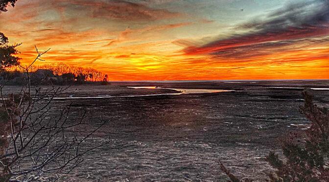 Fiery Sunset Over The Salt Marsh On Cape Cod.