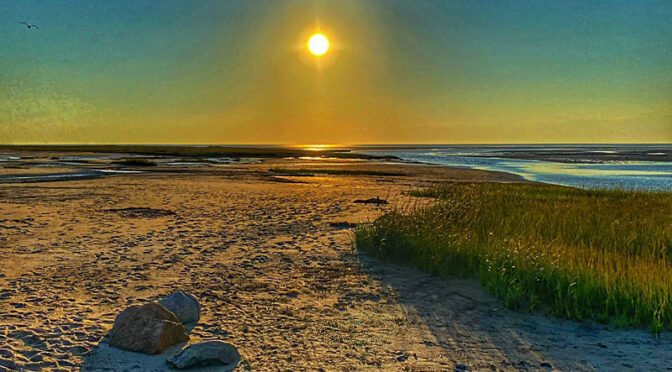 The Sun Is Almost Setting On Cape Cod Bay.
